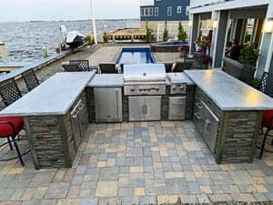 u shaped outdoor kitchen by water