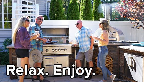 Friends And Family Enjoying an L Shaped Outdoor Kitchen