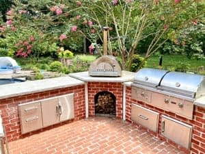 u shaped outdoor kitchen with coyote grills