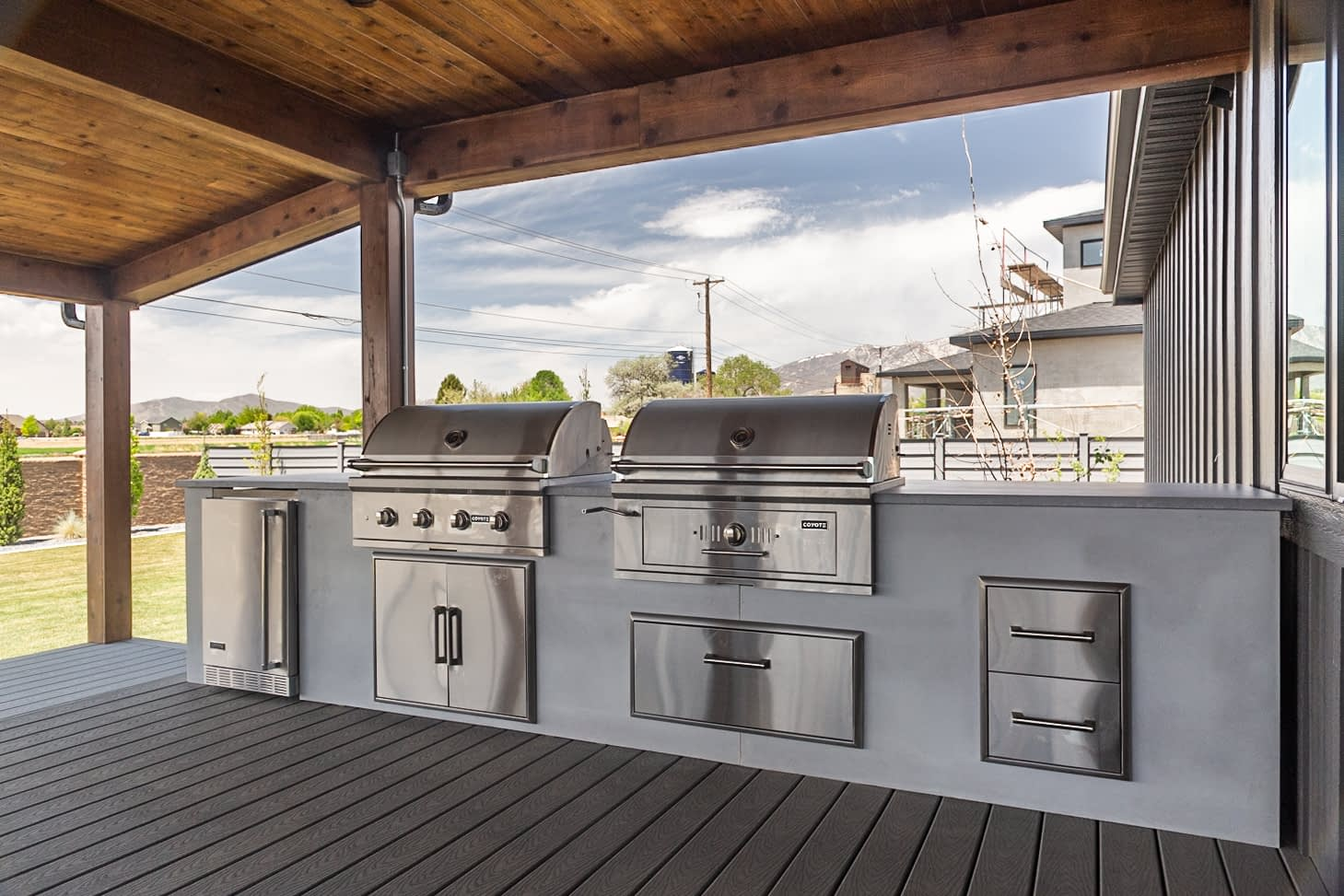 straight outdoor kitchen with two grills on stamped patio (1)