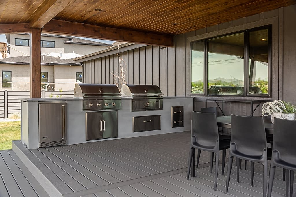 straight outdoor kitchen with two grills on stamped patio (19)