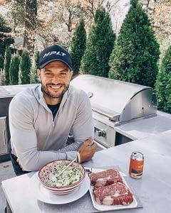 brian mazza at his u shaped outdoor kitchen