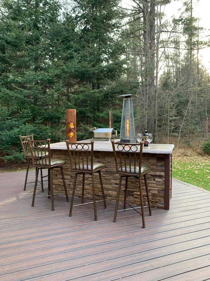 brown outdoor kitchen on brown wood deck