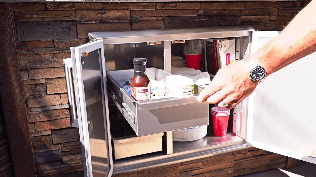 dry pantry being used in outdoor kitchen in outdoor kitchen