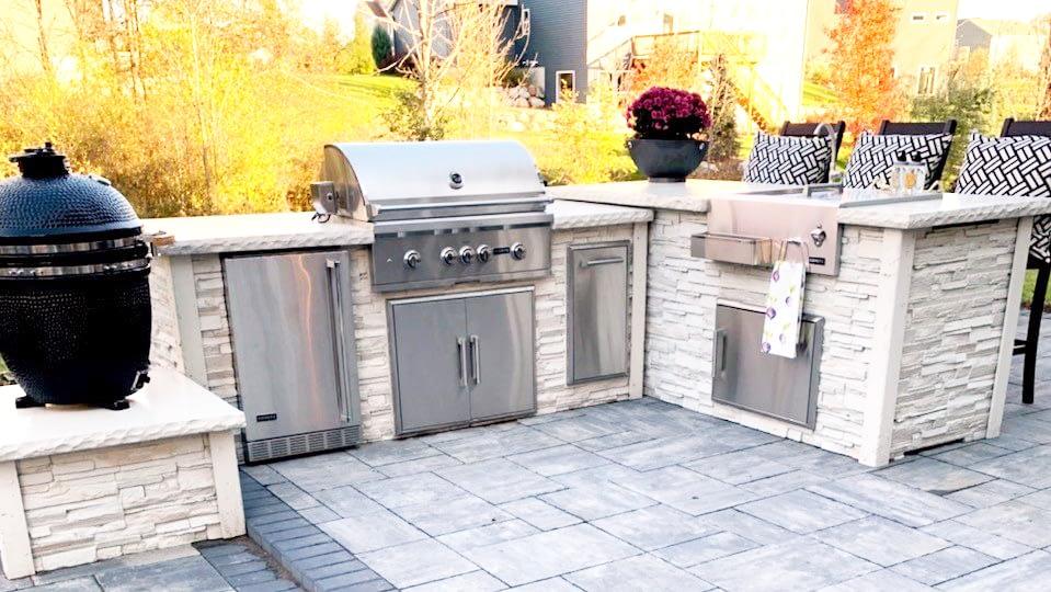 stacked stone white outdoor kitchen
