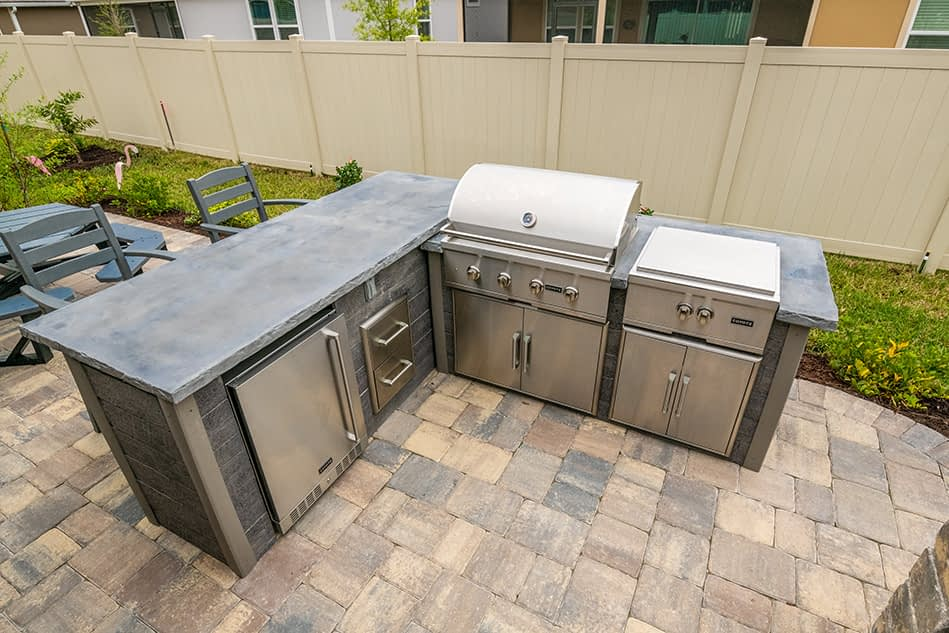 l shape outdoor kitchen with power burner on patio (4)