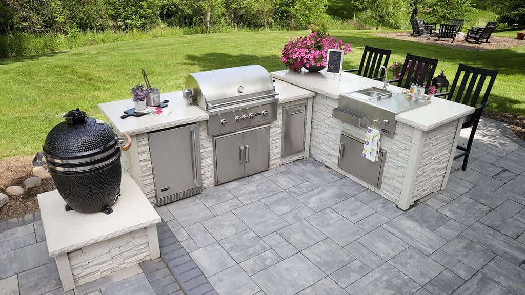 stacked stone white outdoor kitchen during summer