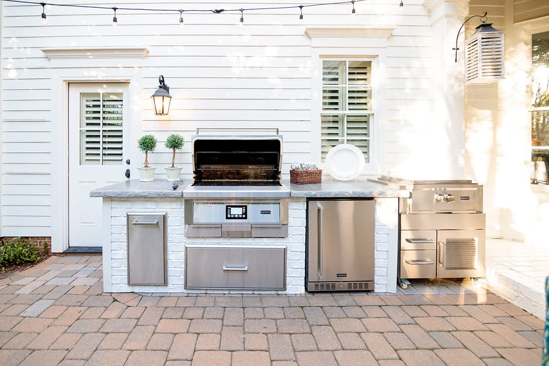 reclaimed brick outdoor kitchen on patio with built in pellet grill (1)