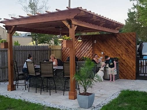 u shaped outdoor kitchen under pergola