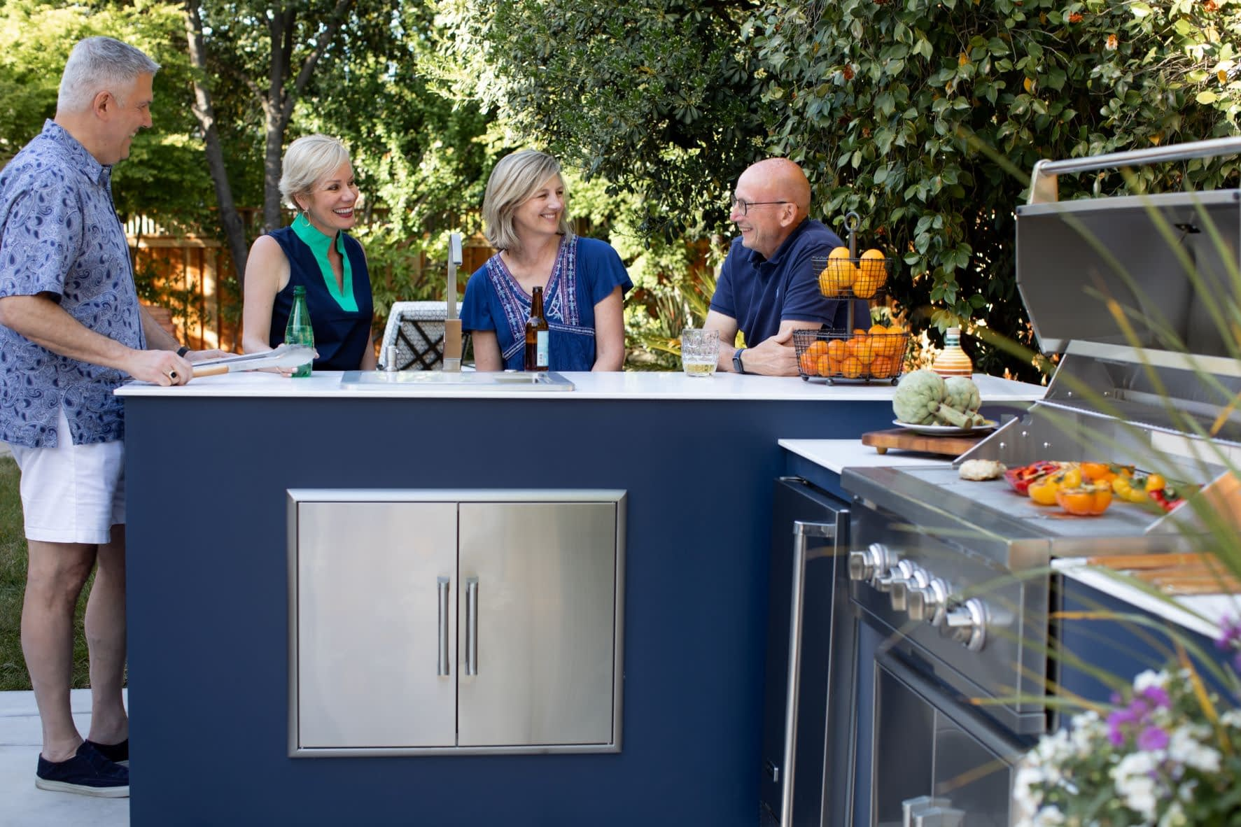 group of friends discussing the hidden costs of outdoor kitchens (1)